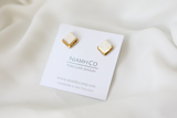 Gold and Porcelain White Square Studs