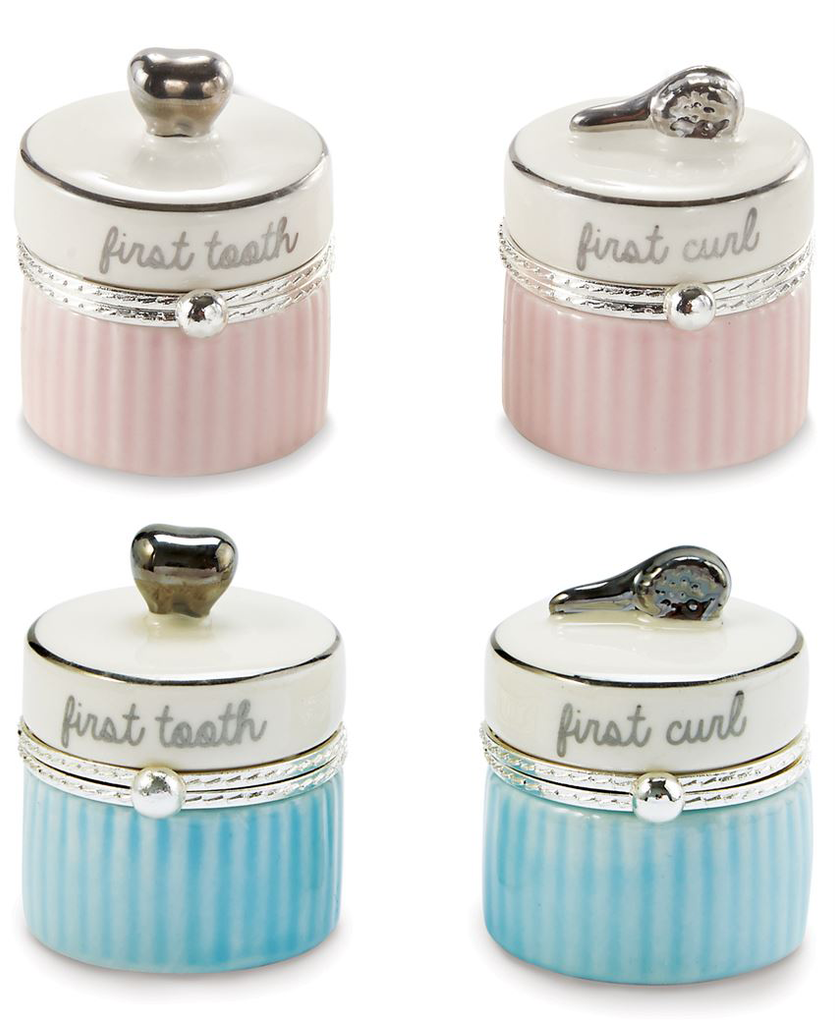 A photo of four small ceramic containers.  The top row features a pair that has alternating pink and dark pink stripes below the clasp, and above it state in script 'first tooth' and 'first curl'.  The left container has a silver tooth on top, and the right container has a silver brush.  The bottom row features the same pair of containers, but the stripes are blue and dark blue.