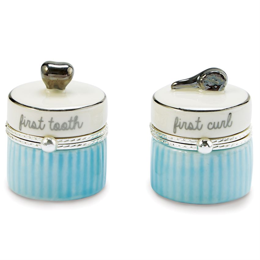 2-piece set. Ceramic tooth and curl keepsake boxes feature silverplate tooth and brush toppers.  The lid is off white with a silver ring around the top, script on the side of the top says 'first tooth' and 'first curl'.  The bottom is alternating vertical blue lines.