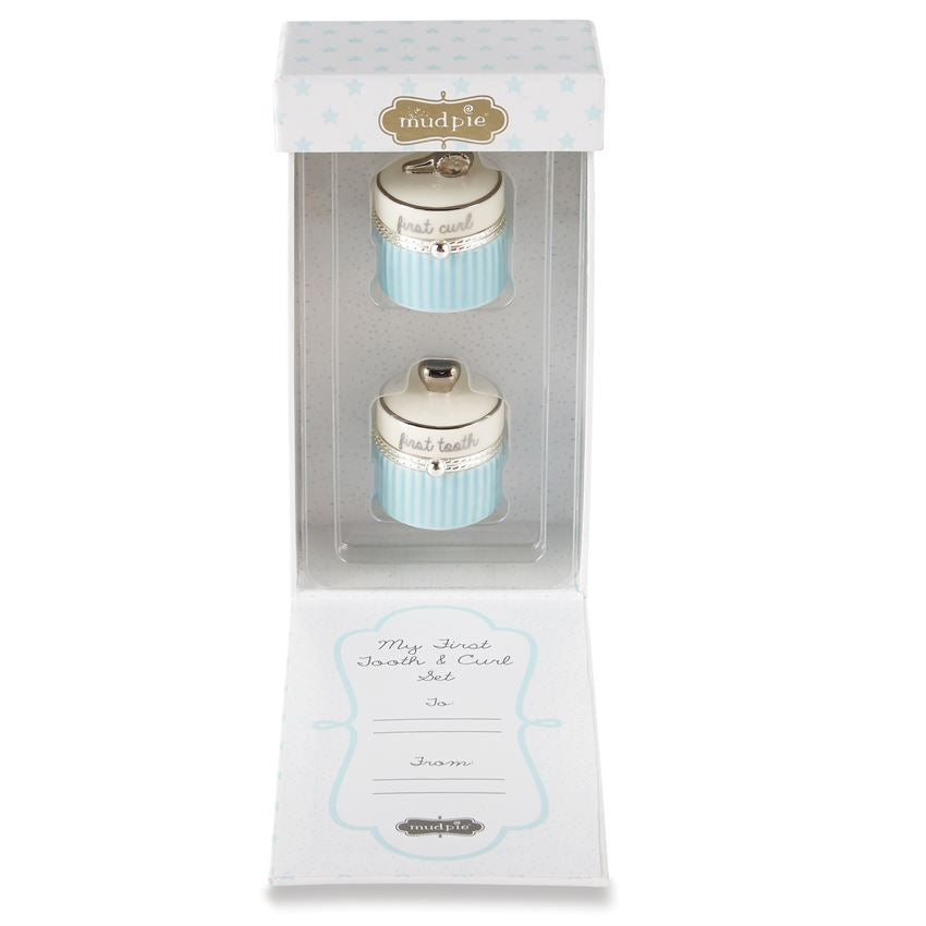 Ceramic first curl and tooth containers in gift box.  Box opens from the front, and each container is in a clear plastic tray.  The inside of the box lid has a place to personalize to and from.