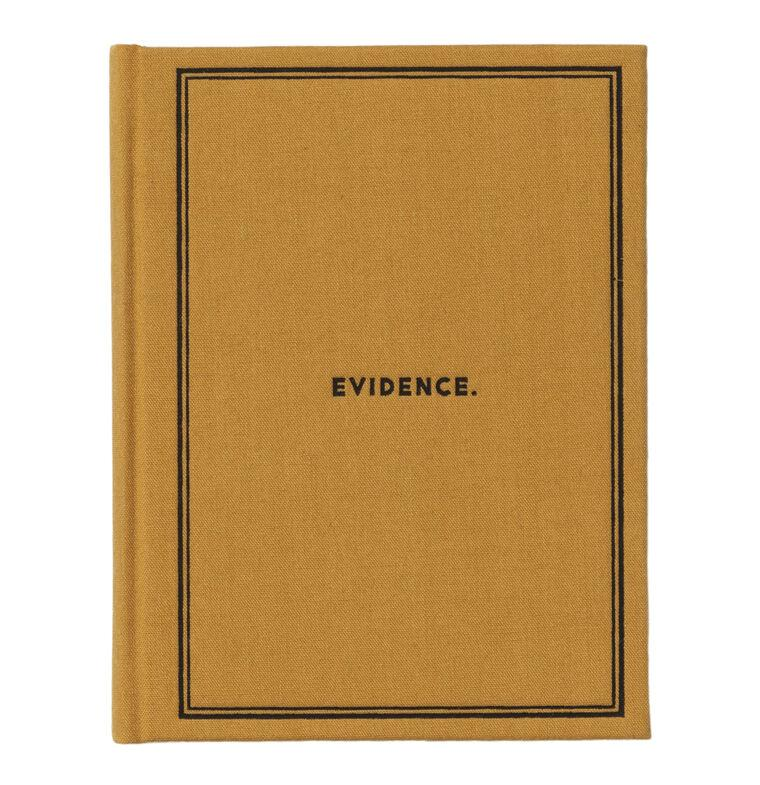 "A yellow hardcover journal with ""Evidence."" on the cover."