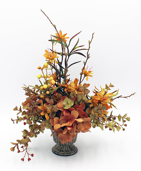 Fall flower arrangement in metal urn.