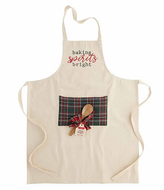 Canvas apron with green tartan plaid pocket.  The text, 'baking spirits bright' is printed on the upper part of the apron in black and red.  A wooden spoon with a red plaid bow is resting on the pocket of the apron.