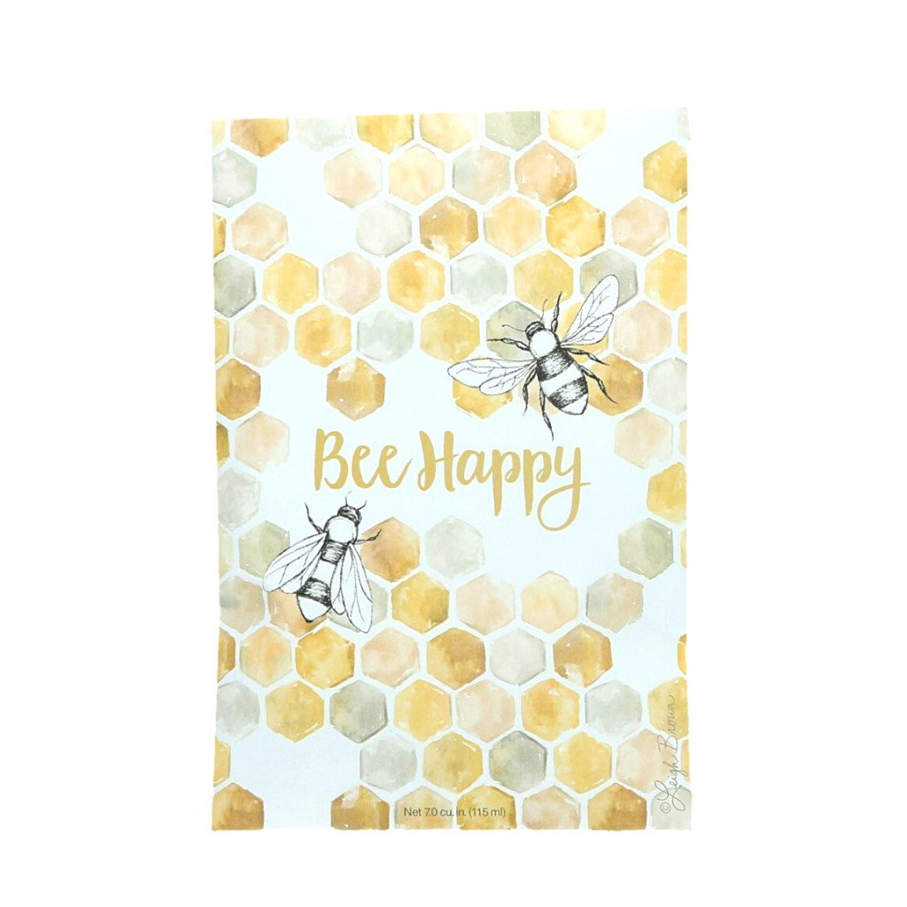 A sachet packet with an image of hexagons linked together like a beehive.  Two drawings of bees are on either side of the text 'Bee Happy'
