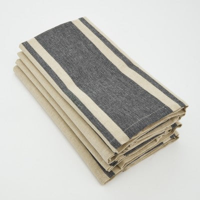 Stack of tan napkins that feature a wide gray stripe in the middle and two thin gray stripes on either side.