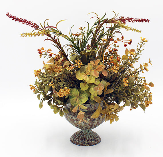 Floral arrangement in a mottled container.