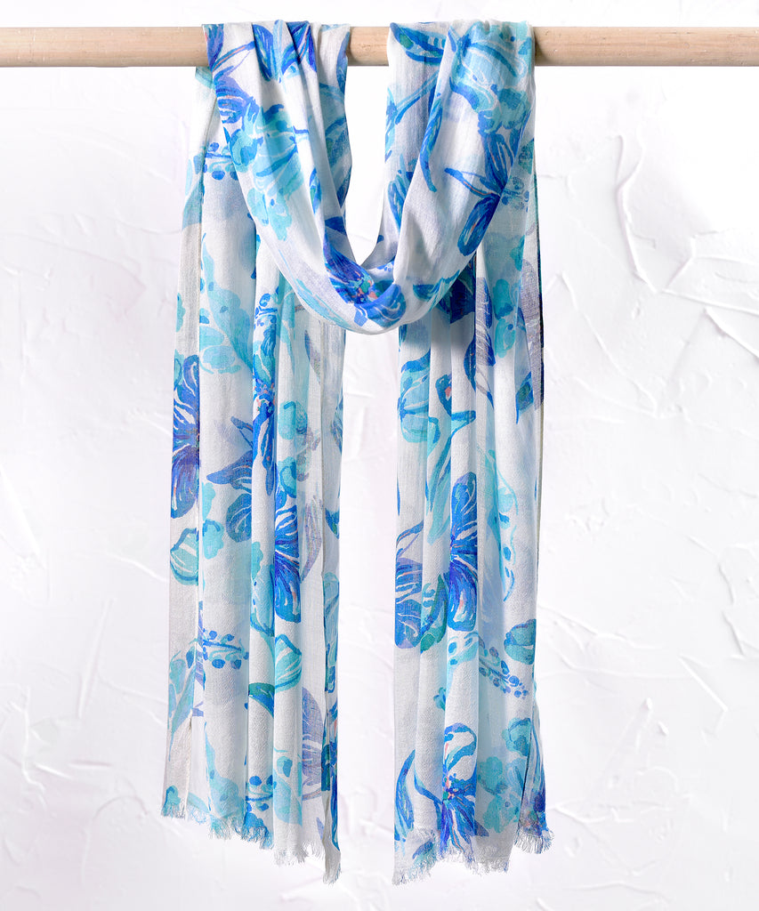 Printed white viscose scarf with large blue flowers and lightly frayed edges