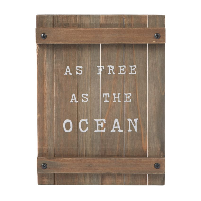"Wooden plank sign with white printed text ""as free as the ocean"