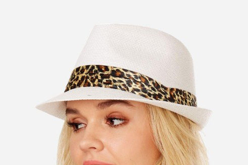 Model wearing a white fedora with a satin leopard print band.