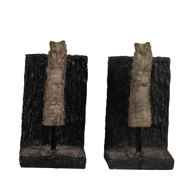 Rustic horse themed bookends.  Horses and supports appear to be carved.  Horses are tan and supports are dark brown.  View from side.