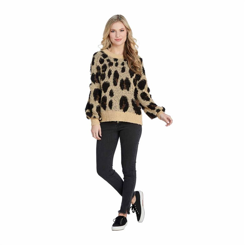 Model wearing leopard boucle sweater.  Tan sweater with black and brown spots.