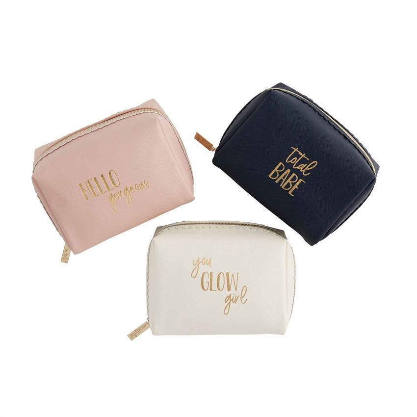 A photo of three square make up bags, each with a saying in gold on them.  From the left, the first is a blush color and says 'hello gorgeous',  the cream one in the middle says 'you glow girl,' and the one on the right is navy and says 'total babe,'