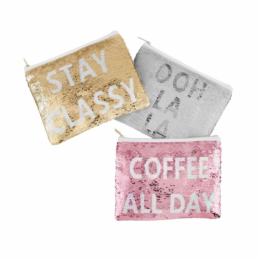 Three sequined cases, each with a top zip enclosure.  The left one says, 'stay classy' in white text on a gold background.  The next one says 'ooh la la' in dark silver text on a white background.  The bottom one says 'coffee all day' in white text on a pink background.