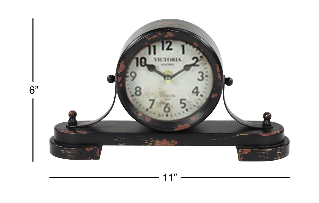 Black distressed clock with measurements to the left and below
