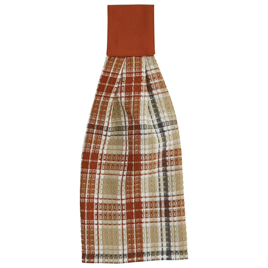 Plaid dishtowel with rust orange, gray, white, and tan.  Features a wide rust orange loop at the top with velcro for easy hanging.