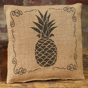 Small burlap pillow with printed black pineapple and border.