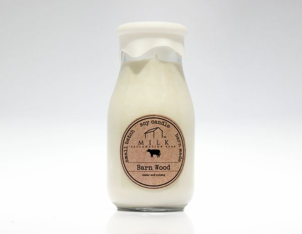 Milk bottle soy candle on white back drop
