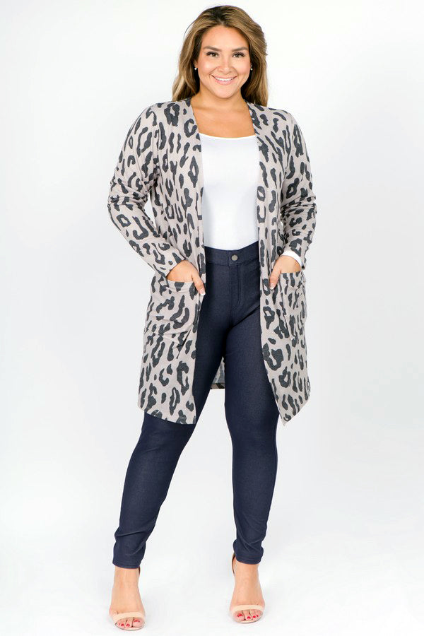 Model wearing leopard print open cardigan.  Cardigan has a beige background and gray spots.  Model is wearing cardigan with open front.