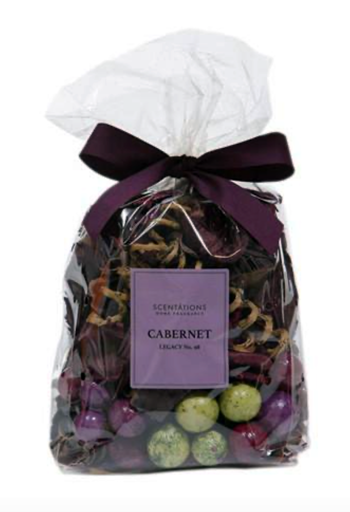"Clear bag of potpourri with purple ribbon tied to the top.  Inside the bag are various dried fruits, flowers and natural items.  A purple label on the bag reads ""Scentations Home Fragrance Cabernet Legacy No. 98"""