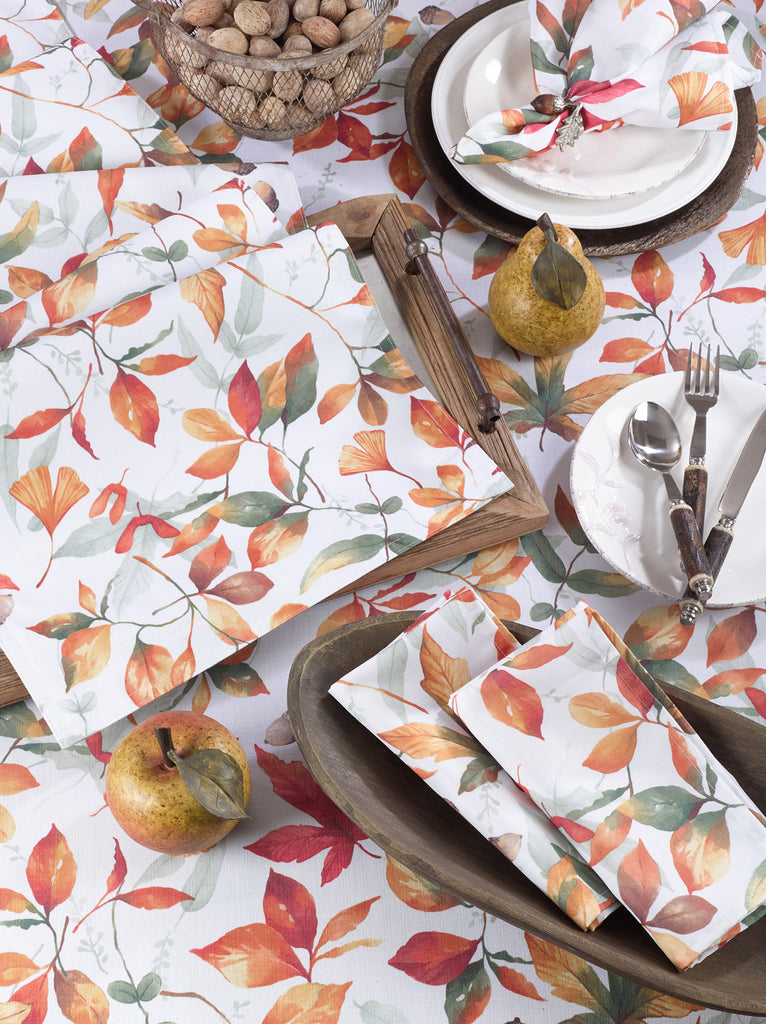 A collection of fall textiles featuring orange and red leaves