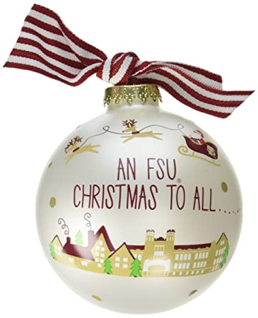 "White glass round ornament with Santa and his reindeer flying over a campus building at Florida State University.  Text above the building says 'An FSU Christmas to all ... and to all, ""Go Noles"".  Ornament has a burgundy and white bow on top."