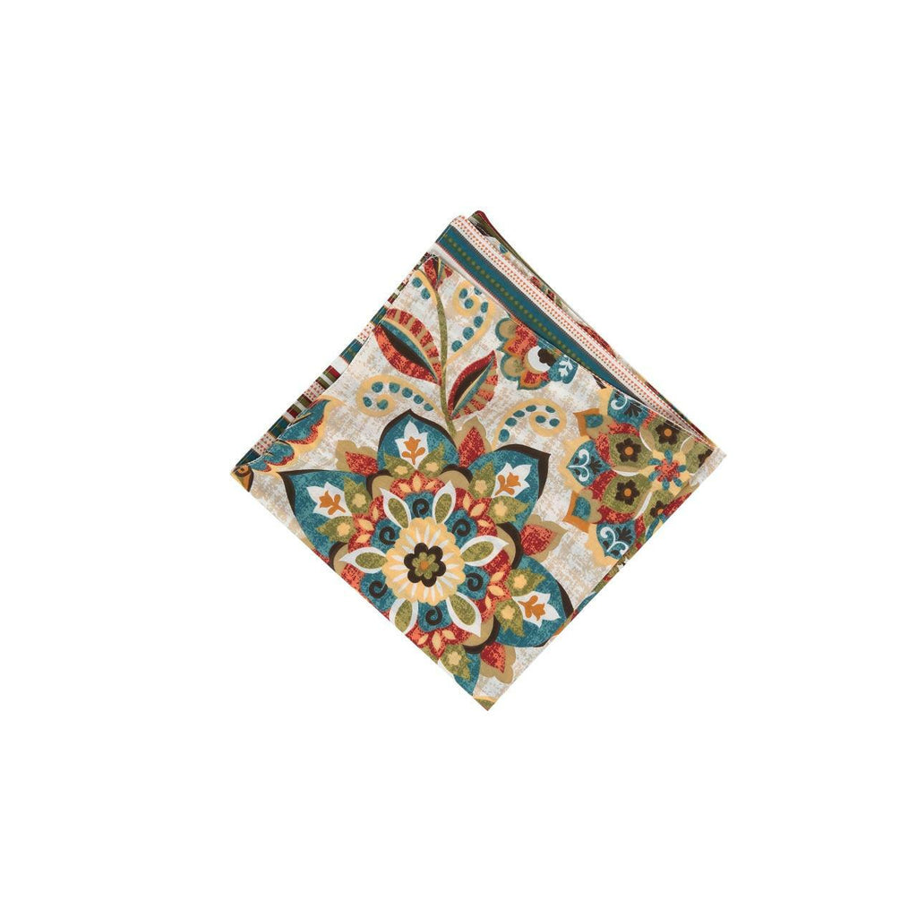 A square folded napkin on a white background.  The pattern is of flowers and leaves in hues of ochre, tomato, blue, green and brown.