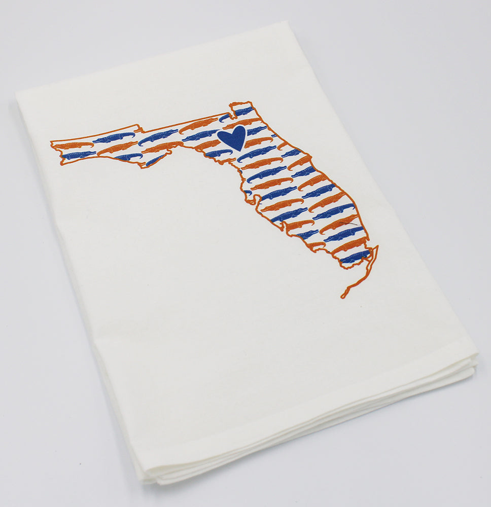 White towel with graphic of the state of Florida and University of Florida orange and blue gator pattern