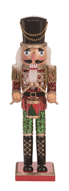 Wooden nutcracker with red glitter jacket and green glitter pants.   Black hat features gold chain.