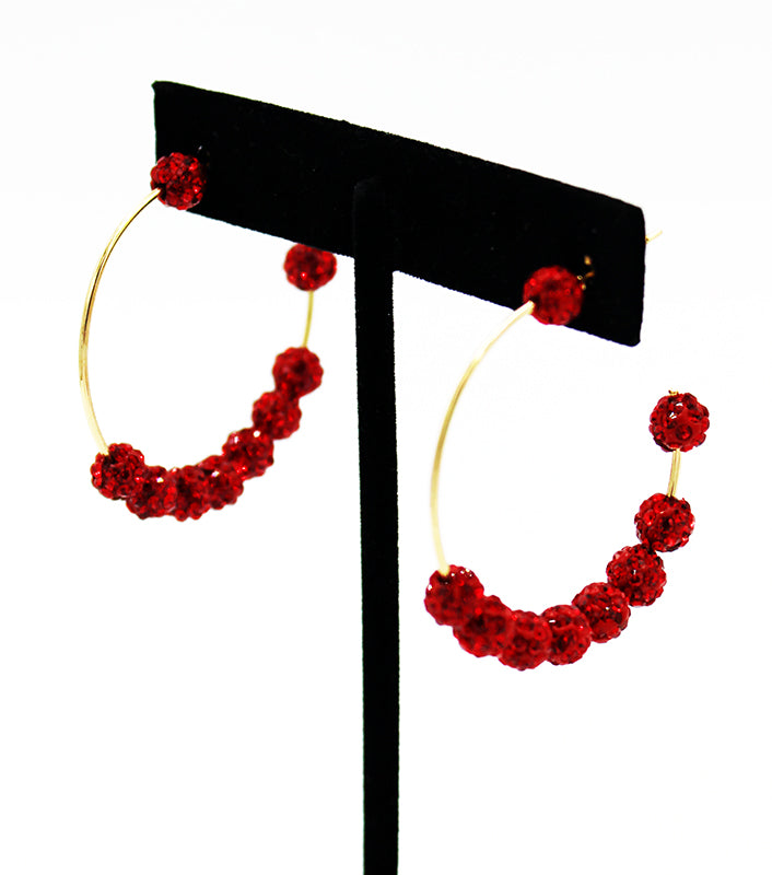 Gold hoops with clusters of red rhinestones.