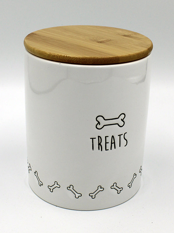 "White ceramic canister with glossy wooden lid.  Side of canister has a graphic of a dog bone in black, as well as a border of dog bones around the bottom of the container.  Below the large bone on the side, is the word ""Treats."""