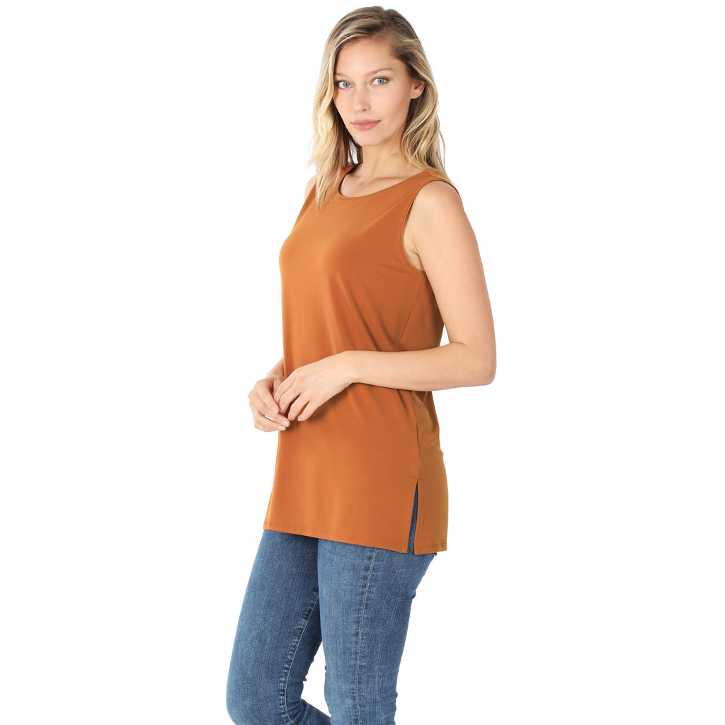 Model wearing a dark orange/rust colored long sleeveless top.
