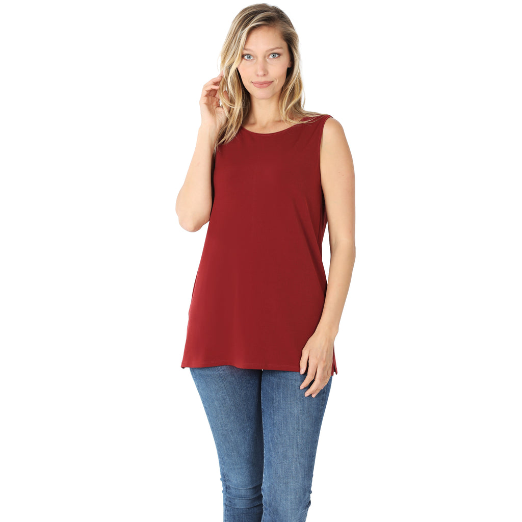Model wearing a dark red colored long sleeveless top.