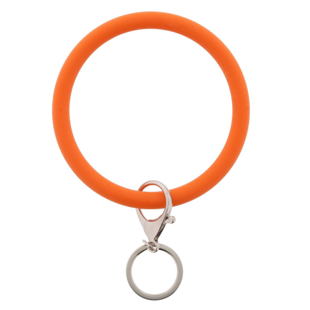 Orange bangle with keychain attachment on white background.