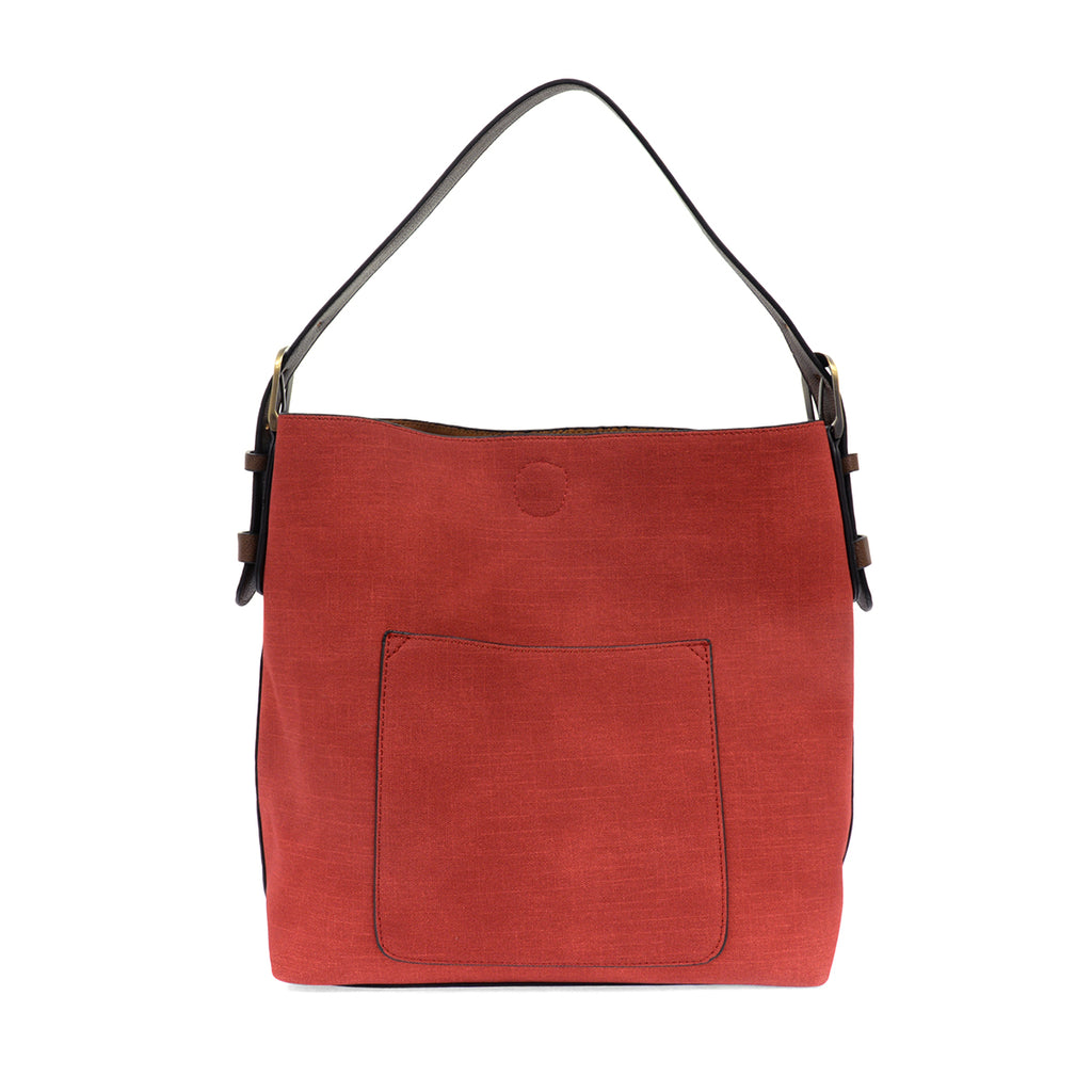 Red faux linen hobo bag with brown buckle strap.
