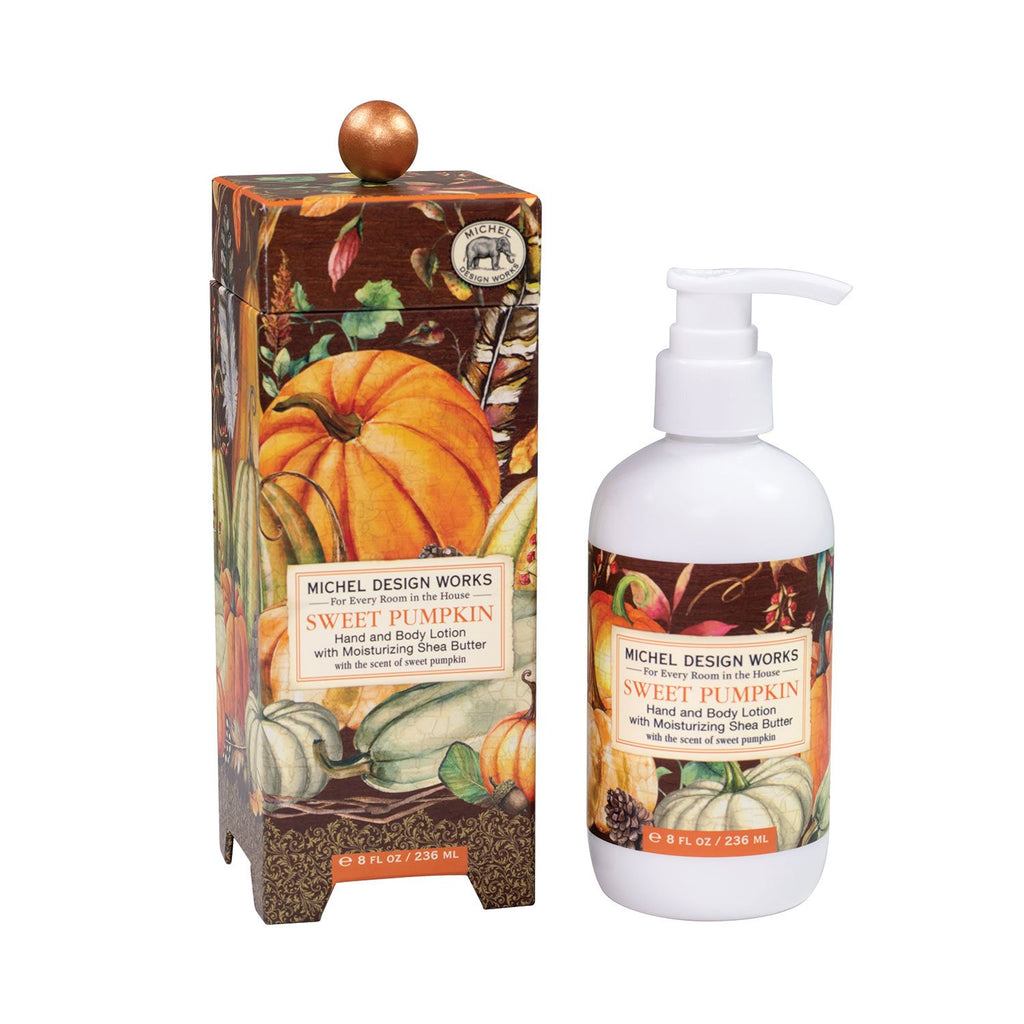 Michel Design works lotion and accompanying gift box.  Box features printed art of pumpkins and gourds with fall leaves on a brown background.  Lotion bottle features a pump and complimentary label to the box design.