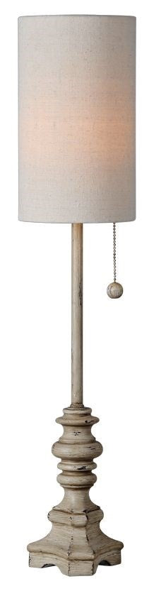 Buffet lamp with a cylindrical shade.  Stem and base are tan and lightly distressed.