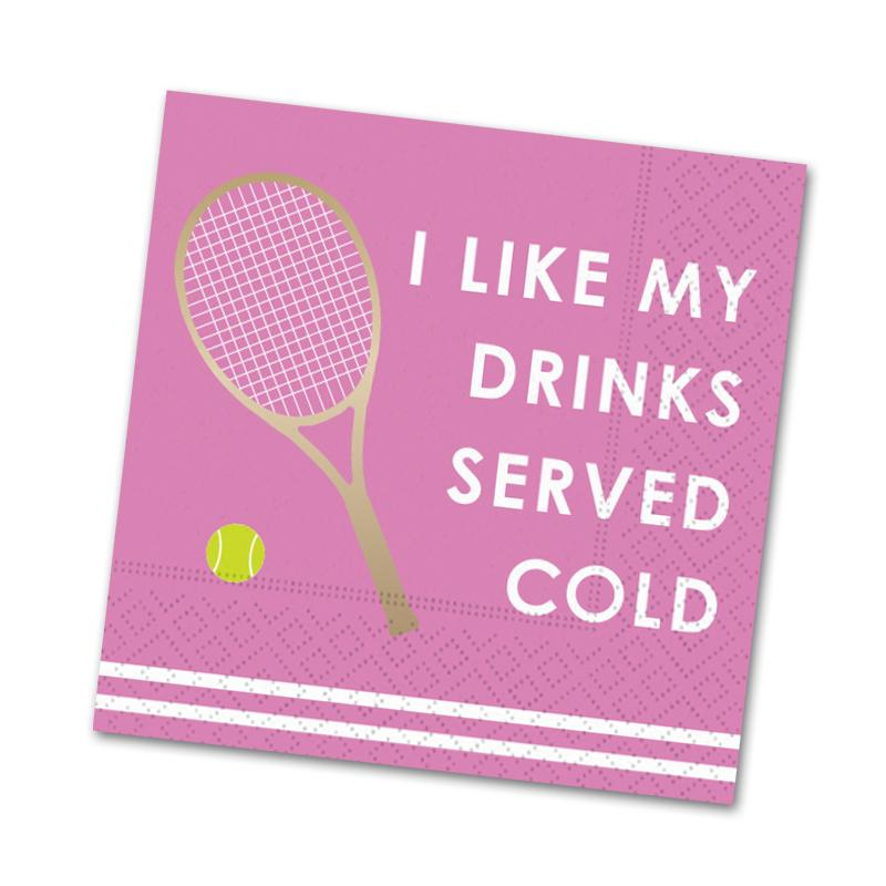 An image of a pink napkin with two white horizontal stripes on the bottom.  A gold foil tennis racket next to a tennis ball is adjacent to the text 'I Like My Drinks Served Cold'