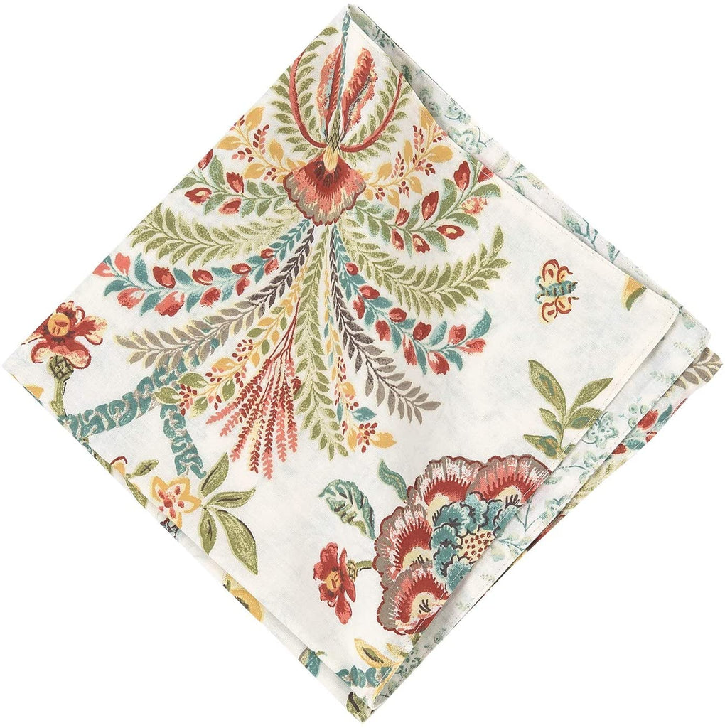 A folded cloth napkin on a white background.  The pattern is jacobean flowers with leaves and vines.