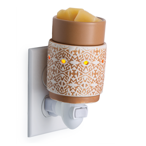 White and brown terracotta pluggable fragrance warmer plugged into wall socket