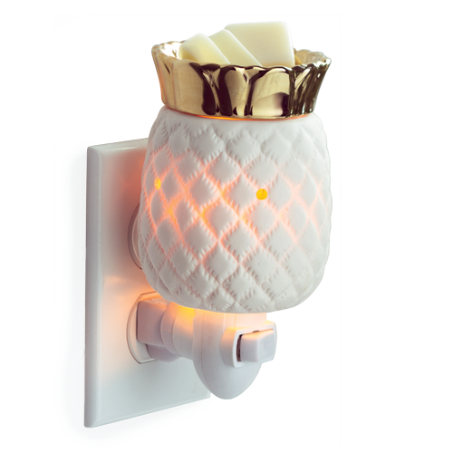 Pineapple shaped candle warmer.  Item is white ceramic with an internal glow, and topped with golden metallic fronds.