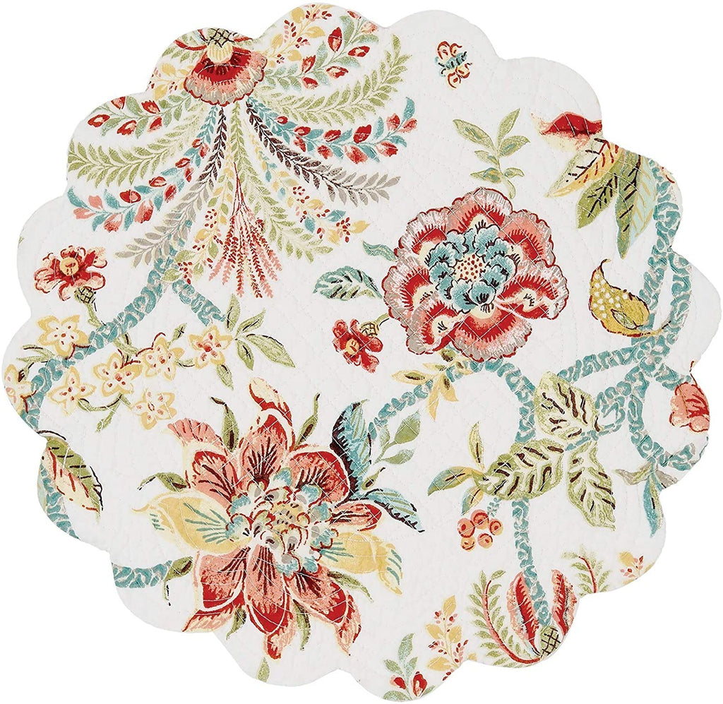 A round quilted placemat with scalloped edges on a white background.  The pattern is jacobean flowers with leaves and vines.