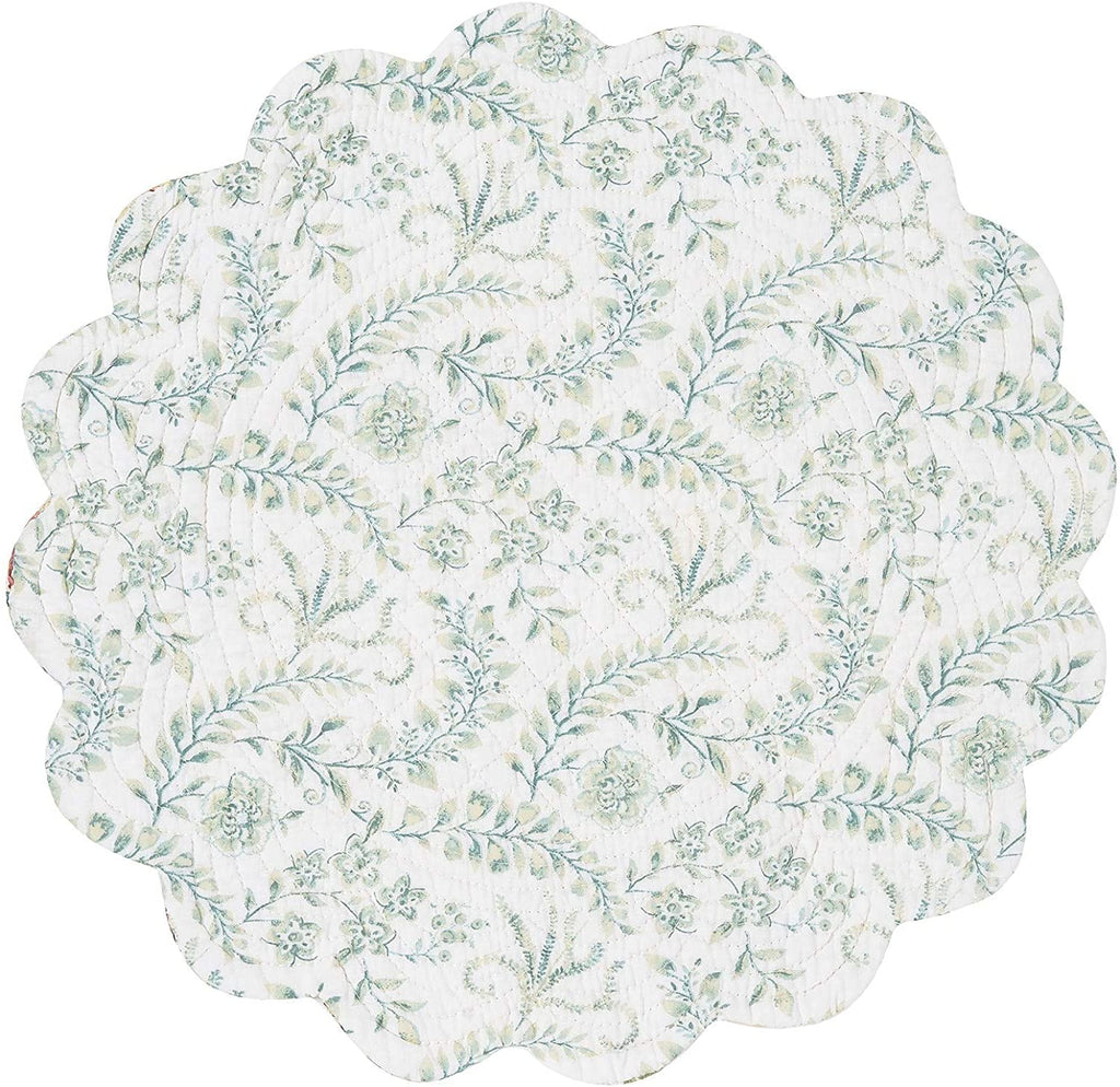Reverse side of a round quilted placemat with scalloped edges on a white background.  The pattern is jacobean flowers with leaves and vines.