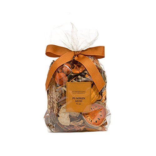 "A clear bag of potpourri with an orange ribbon tied in a bow.  Label reads ""Scentations Pumpkin Seed No. 7412"".  Bag is filled with a variety of dried items ranging from oranges, cinnamon and more."