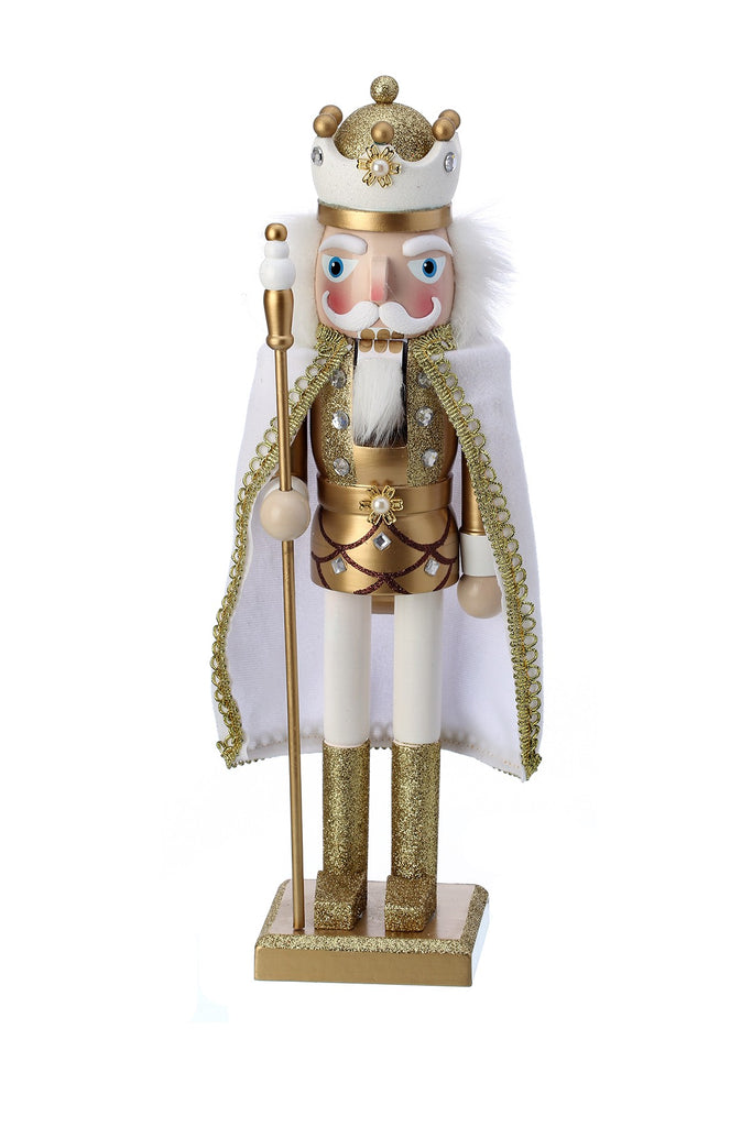 "15"" tall shimmering gold and white wooden nutcracker holding staff."