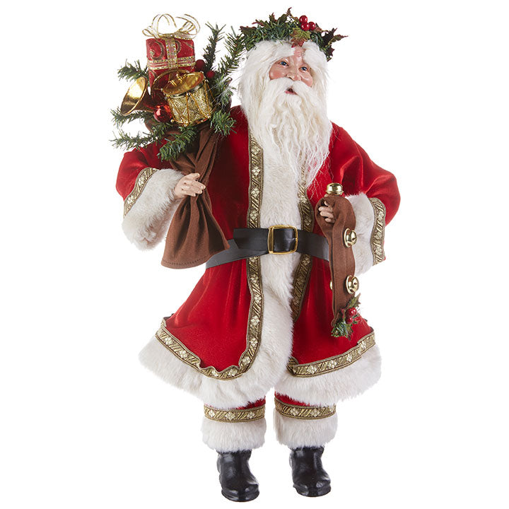 Santa figure holding a bag of gifts in his right hand and a strap with bells in his left hand.