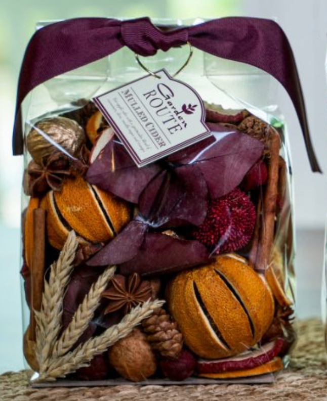 Bag of Mulled Cider potpourri in a clear bag showcasing all of the dried elements such as wheat, oranges, cinnamon, vanilla and more.
