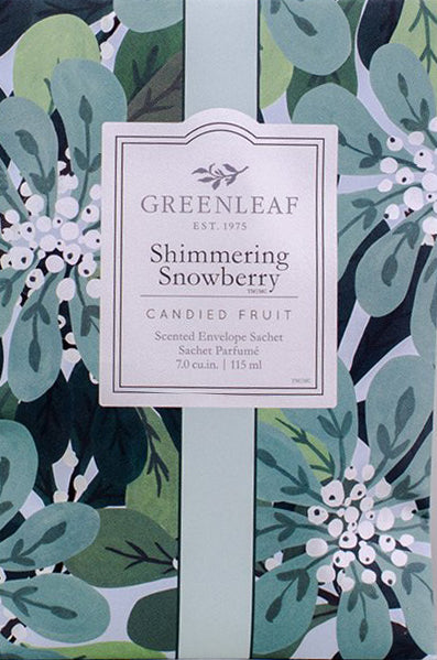Close up of sachet packet for Shimmering Snowberry, candied fruit.  Green leaves and white berries are on either side of the white label.