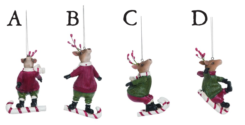 Four different reindeer ornaments each using candy canes as skates/sleds in a different pose.  Each reindeer is wearing a festive sweater, pants, boots, and scarf, and has red berries in their antlers.