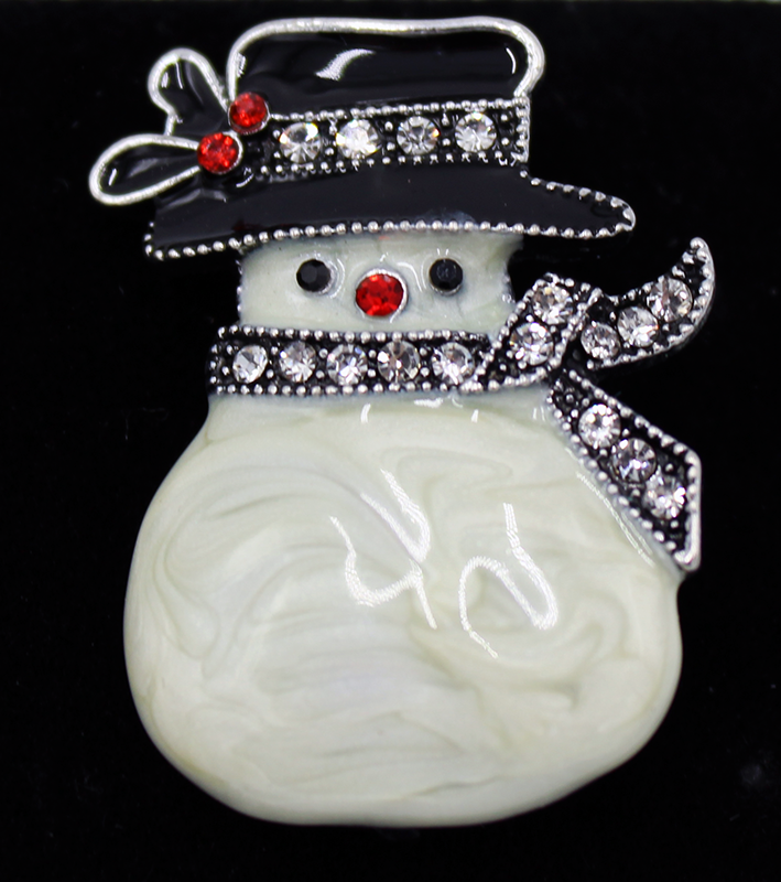 This fancy snowman has a lovely burled texture on his body and rhinestone details in the scarf, nose, eyes, and hat.