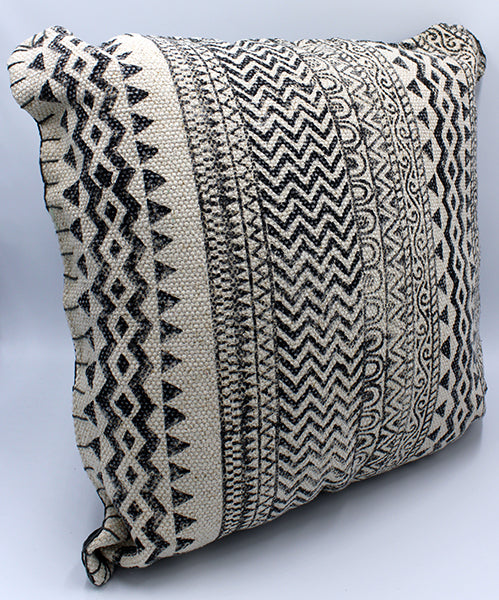 Hi textured off-white cotton pillow with gray printed multi-patterned design.